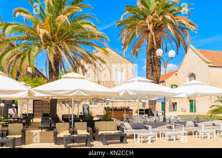 TROGIR TOWN, CROATIA - SEP 6, 2017: restaurant tables with umbrellas in old town of Trogir on sunny summer day, - Stock Photo