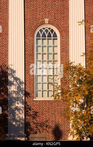 Window at a typical red brick hall at Harvard University in Cambridge, MA, USA - Stock Photo