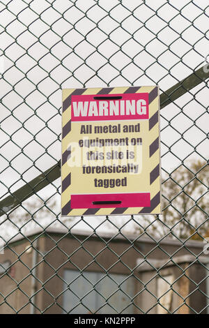 Warning All metal and equipment on this site is forensically tagged sign on security fence in Edinburgh, Scotland, - Stock Photo