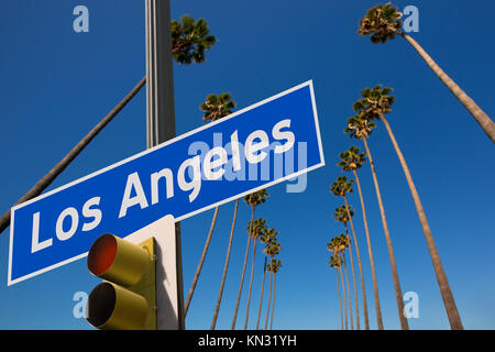 LA Los Angeles palm trees in a row typical California with road sign digital composite - Stock Photo