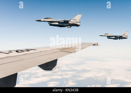 Two F-16 fighter jets of the Royal Netherlands Air Force during a tanker mission with a KDC-10 over the North Sea. - Stock Photo