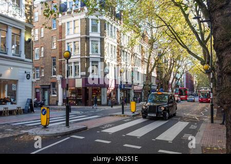 London black cab taxi at a pedestrian crossing on Grey's Inn Road, Holborn, London - Stock Photo