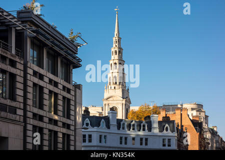 Spire of St Bride's Church, Fleet Street, viewed above the rooftops of buildings on Ludgate Circus. City of London, - Stock Photo