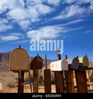 Mailboxes mail box aged vintage in west California desert. - Stock Photo