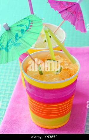 two glasses with cocktail and umbrellas shoot in studio. - Stock Photo