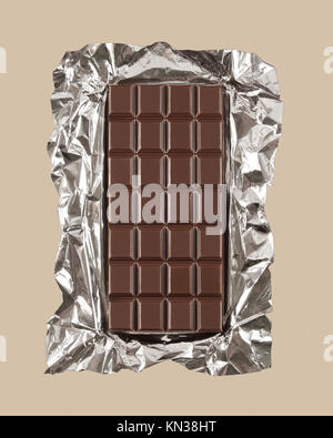 Chocolate candy bar with foil wrapper unwrapped. - Stock Photo