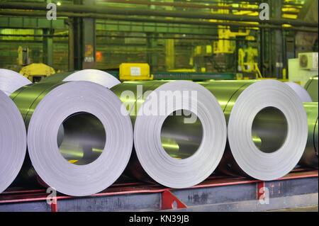 rolls of steel sheet in a warehouse. - Stock Photo