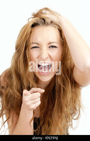 Frustrated Girl with Long Brown Hair Screaming, Pointing with Index Finger. - Stock Photo