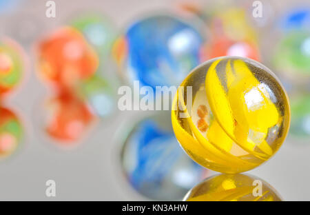 Closeup on many colorful glass marbles. - Stock Photo