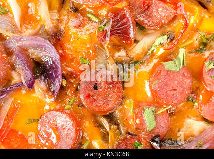 background of Italian pizza with vegetables and sausage. - Stock Photo