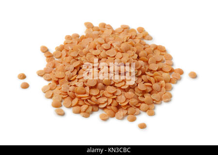 Heap of red lentils on white background. - Stock Photo