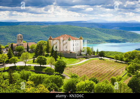 chateau and church in Aiguines and St Croix Lake at background, Var Department, Provence, France. - Stock Photo