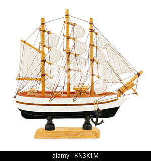 Old sailboat model isolated on white background. - Stock Photo