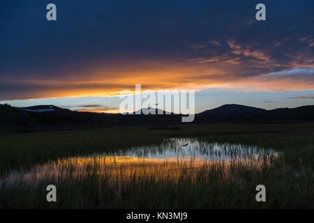 The sun sets over Swan Lake Flats at the Yellowstone National Park June 11, 2017 near Lake, Wyoming.  (photo by - Stock Photo