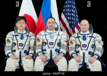 Official portrait of NASA International Space Station Expedition 54-55 prime crew members (L-R) Japanese astronaut - Stock Photo