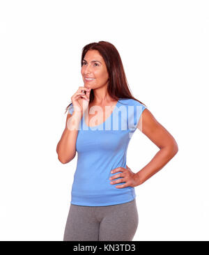 Portrait of a pensive sporty senior woman in gym clothing against white background - copyspace. - Stock Photo