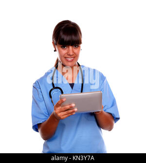 Portrait of a smiling medical doctor woman using her tablet pc on blue uniform with a stethoscope on isolated background. - Stock Photo