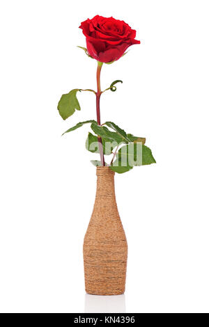 Red rose in decorative vase isolated on white background. Closeup. - Stock Photo