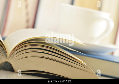 Composition with books and cup of coffee on the table. - Stock Photo