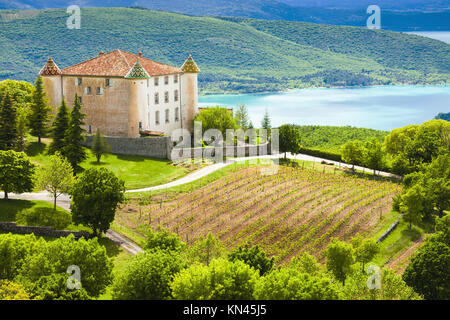 chateau in Aiguines and St Croix Lake at background, Var Department, Provence, France. - Stock Photo