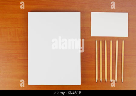 Corporate ID set on wood background for presentations and portfolios. - Stock Photo