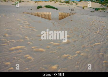 Wooden Fences door On Deserted Beach Dunes In Tarifa, Spain. - Stock Photo