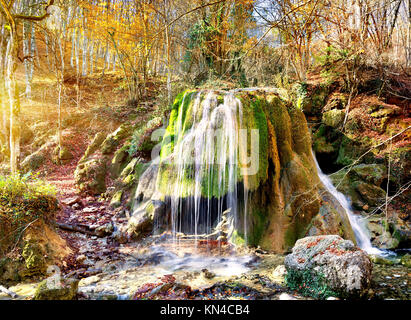 Autumn waterfall in the mountains of Crimea. - Stock Photo