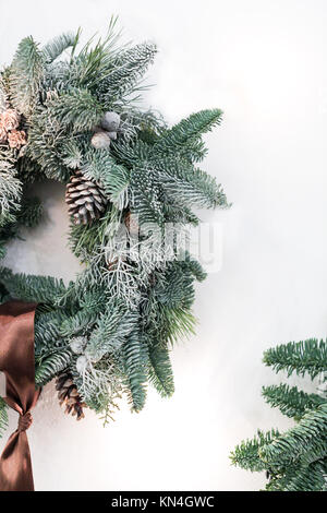 interior design, celebration, home atmosphere concept. simple but lovely wreath made of fresh conifer branches, - Stock Photo