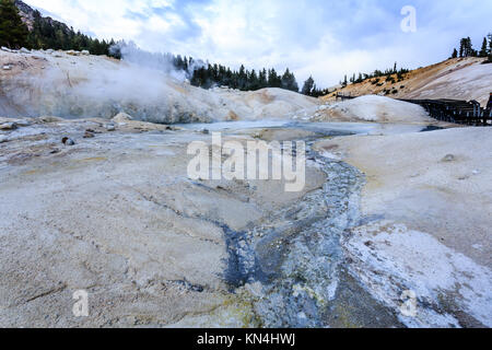 Closeup of the thin but colorful crust over the  dangerous boiling springs and hot mud pots in Lassen Volcanic National - Stock Photo