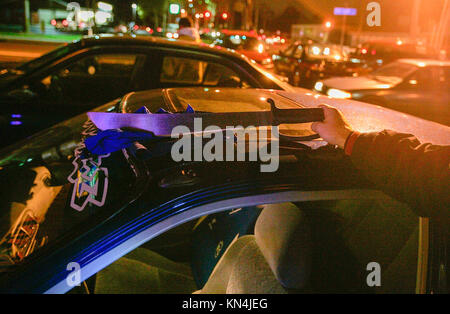 Suffolk County Police officers from the anti-gang unit show a machette found in a car of possible gang members of - Stock Photo