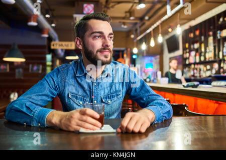 Happy Drunk Man in Bar - Stock Photo