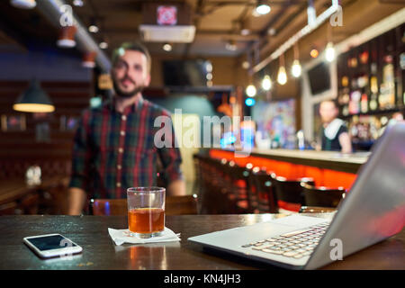 Young Man Working in Bar - Stock Photo