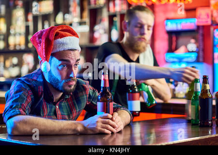 Drunk Man in Pub on Christmas - Stock Photo