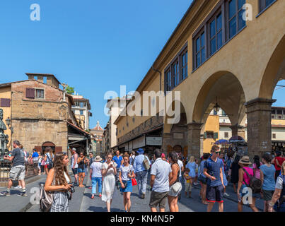 Crowds of tourists on the Ponte Vecchio, Florence, Italy. - Stock Photo