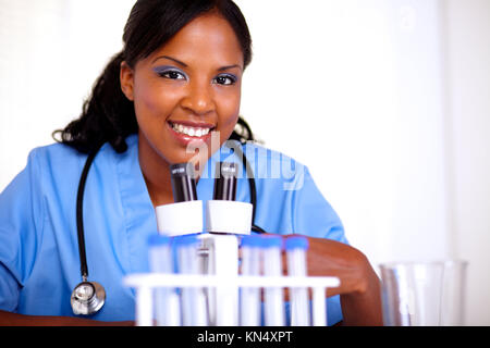 Afro-american nurse woman looking at you at laboratory - copyspace. - Stock Photo