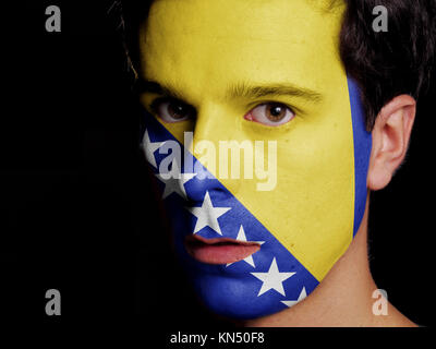 Flag of Bosnia and Herzegovina Painted on a Face of a Young Man. - Stock Photo