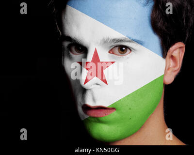 Flag of Djibouti Painted on a Face of a Young Man. - Stock Photo