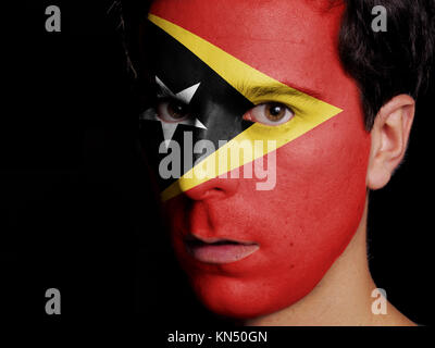 Flag of East Timor Painted on a Face of a Young Man. - Stock Photo