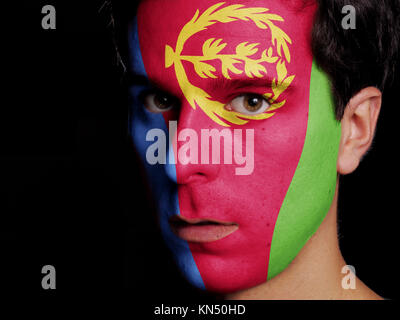 Flag of Eritrea Painted on a Face of a Young Man. - Stock Photo