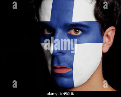 Flag of Finland Painted on a Face of a Young Man. - Stock Photo
