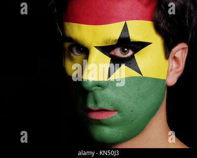 Flag of Ghana Painted on a Face of a Young Man. - Stock Photo