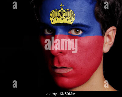 Flag of Liechtenstein Painted on a Face of a Young Man. - Stock Photo