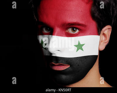 Flag of Syria Painted on a Face of a Young Man. - Stock Photo