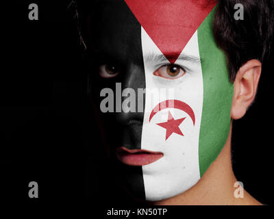Flag of Sahrawi Arab Democratic Republic Painted on a Face of a Young Man. - Stock Photo