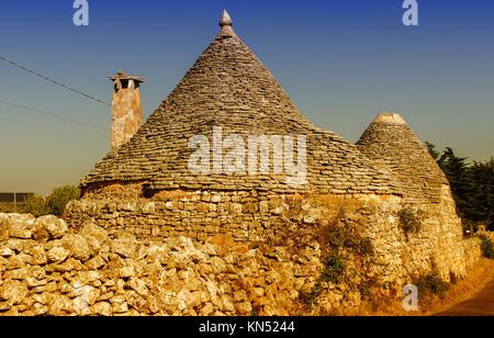 Apulia, Italy. Unique Trulli houses with conical roofs in Alberobello - Puglia, Italia. - Stock Photo