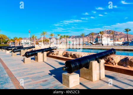 Cartagena cannon in naval museum with port at Murcia Spain. - Stock Photo