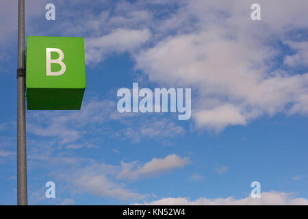 Parking signal pole of letter B area over blue cloudy sky. - Stock Photo