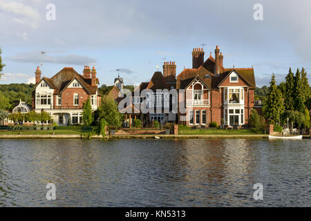old houses and a white canoe over river Thames, Marlow, England, old houses and a white canoe on river Thames enbakment, - Stock Photo