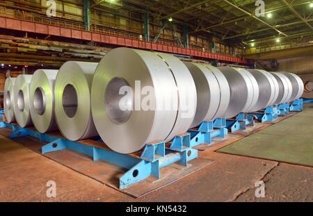 rolls of steel sheet in a factory. - Stock Photo