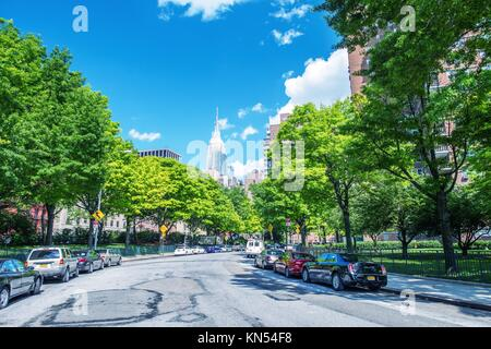 Beutiful view of New York skyline and avenue from Chelsea Park area - Manhattan in summer season. - Stock Photo